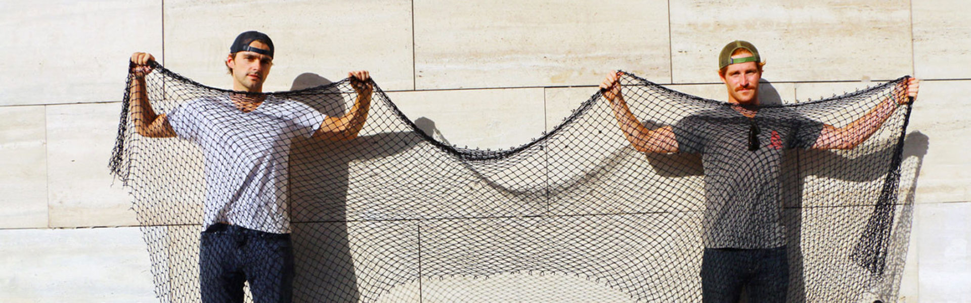 bureo co-founders holding rescued fishing net