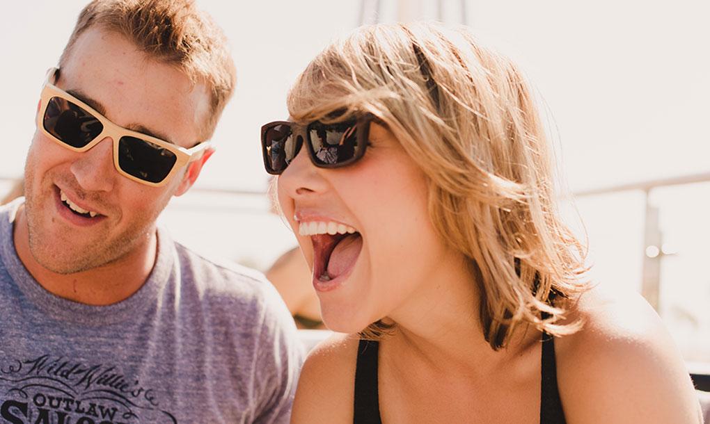couple wearing panda sunglasses;asses