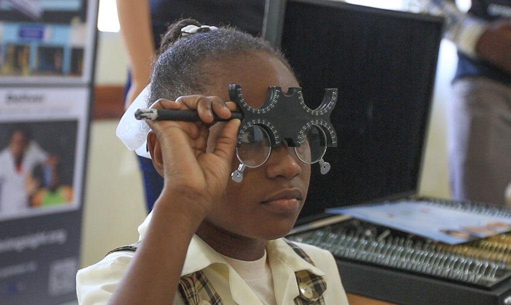 little girl having eye test with Optometry Giving Sight