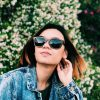 panda Monroe sustainably made bamboo sunglasses in brown - worn by female model
