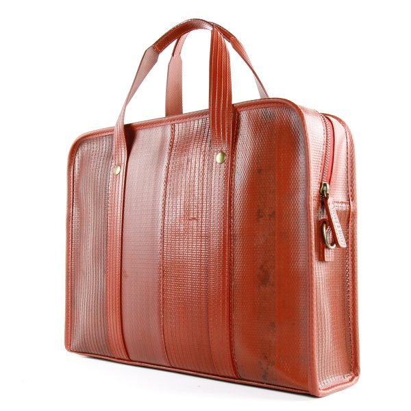 elvis and kresse ethical firehose briefcase in red shown at an angle