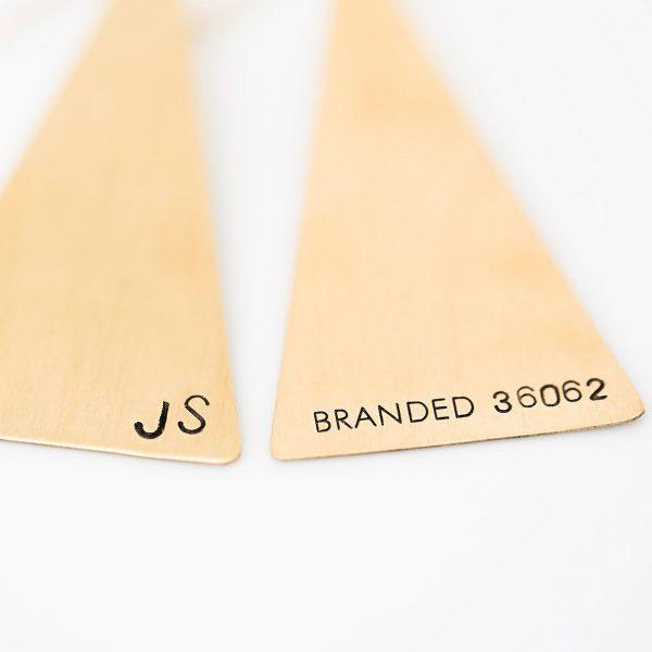 branded triangle brass earrings main image