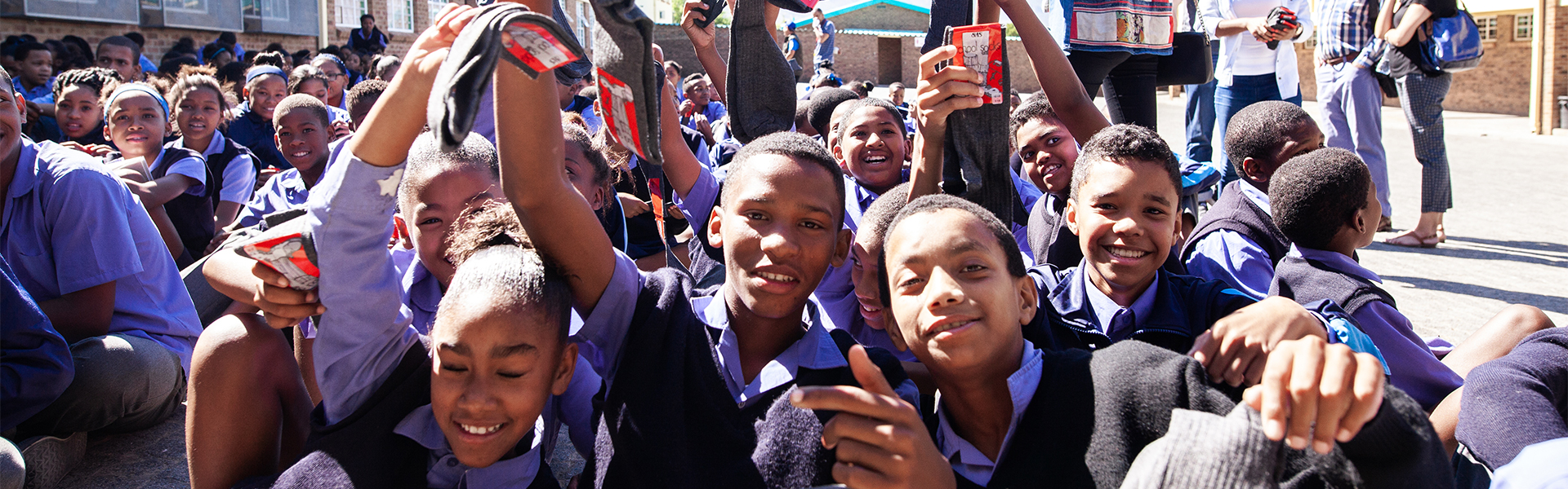 donating socks to school kids in South Africa