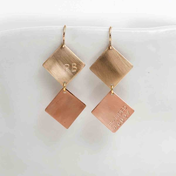 ethically made metal diamond shaped earrings made by survivors of human trafficking