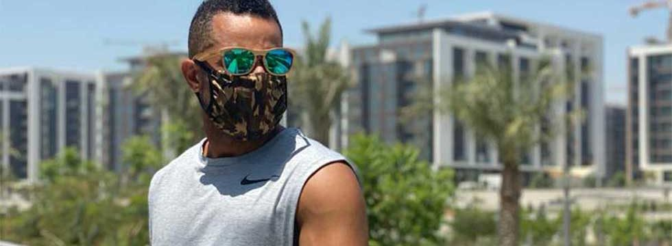 model wearing one good thing camoflage fabric face mask